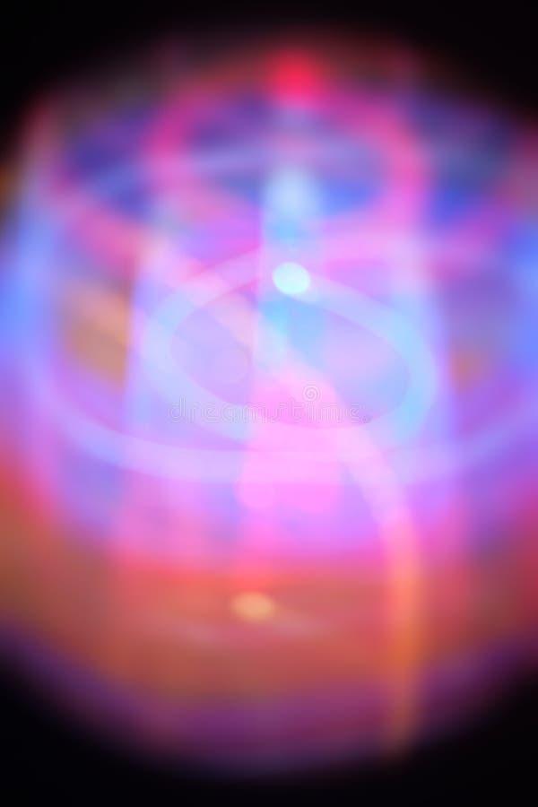 Violeta e fundo borrado lightpainting azul imagem de stock
