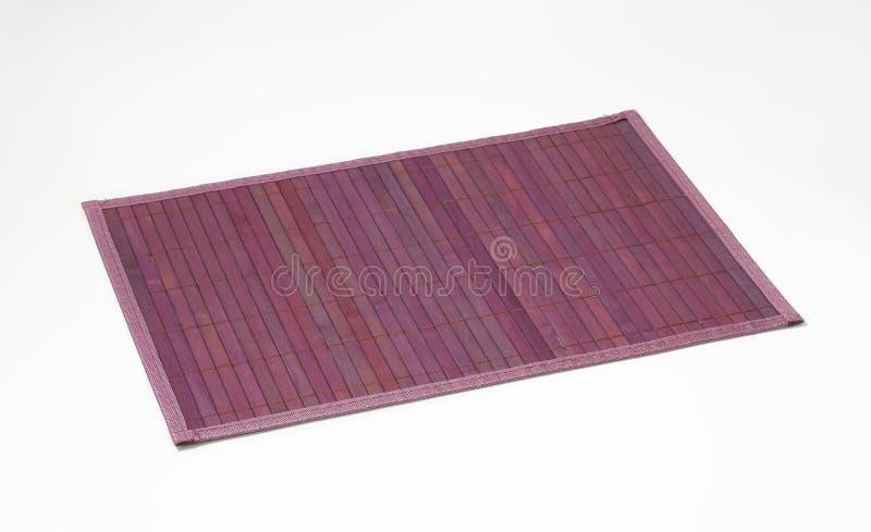 Violette Bambusplatzmatte stockfotos