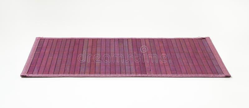Violette Bambusplatzmatte lizenzfreies stockfoto