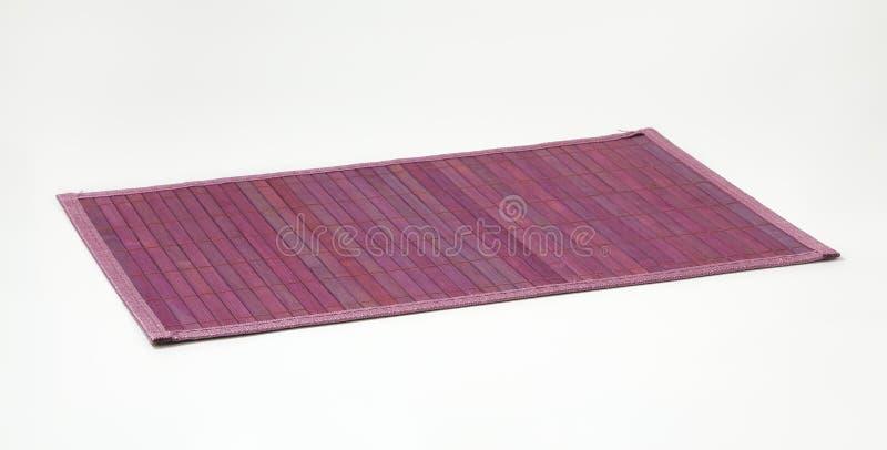 Violette Bambusplatzmatte stockbilder
