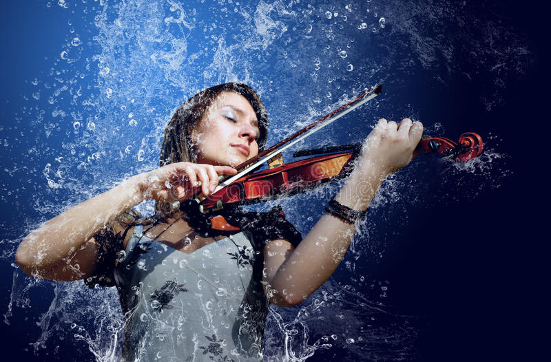 Violin. Musician playing violin under water royalty free stock photography