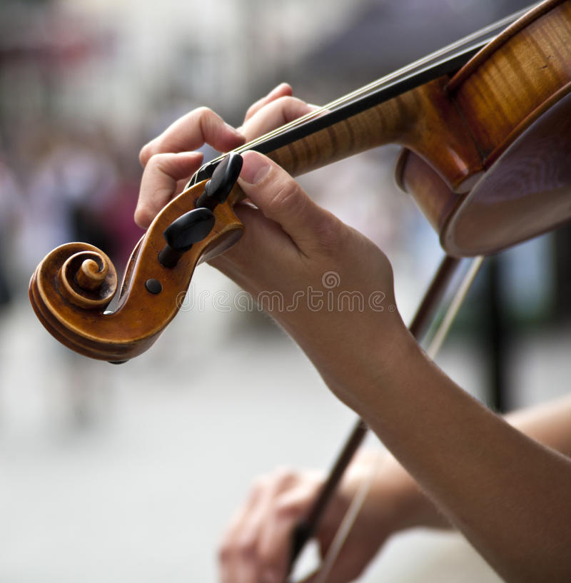 Violin. Close up of violin and musicians hand stock image