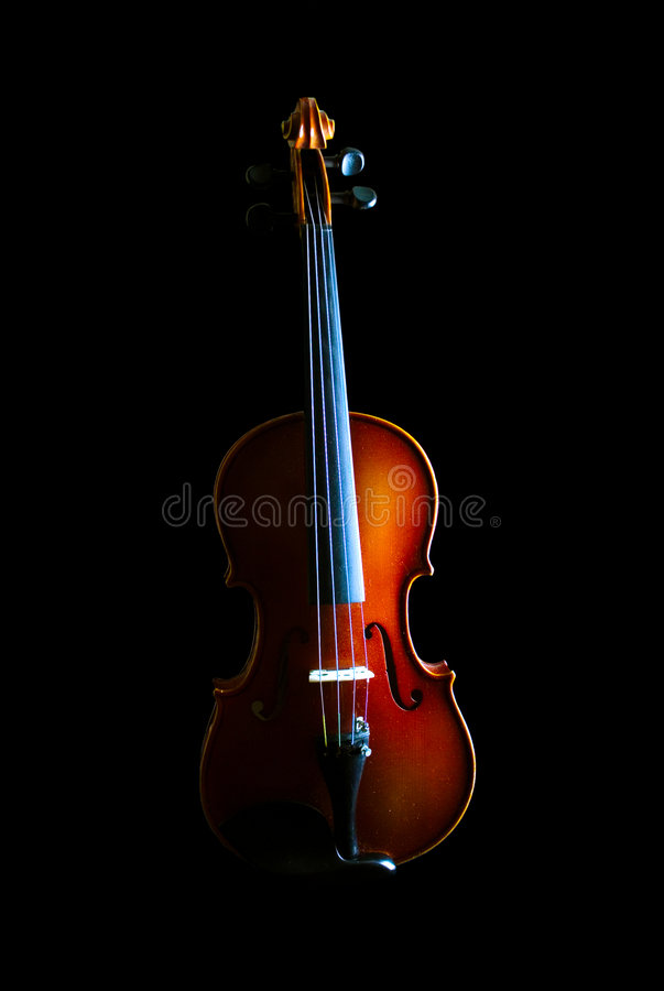 The Violin. Violin with sidelight and black background royalty free stock photos