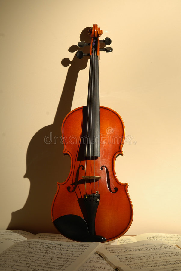 Violin. A violin with background score stock photo