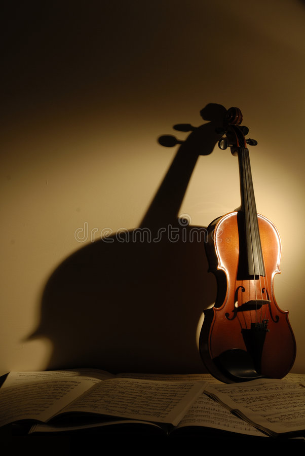 Violin. A violin with background score royalty free stock photos