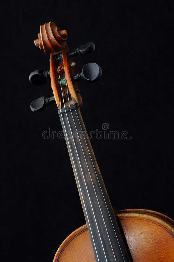 Violin. A view with a violin details on black royalty free stock images