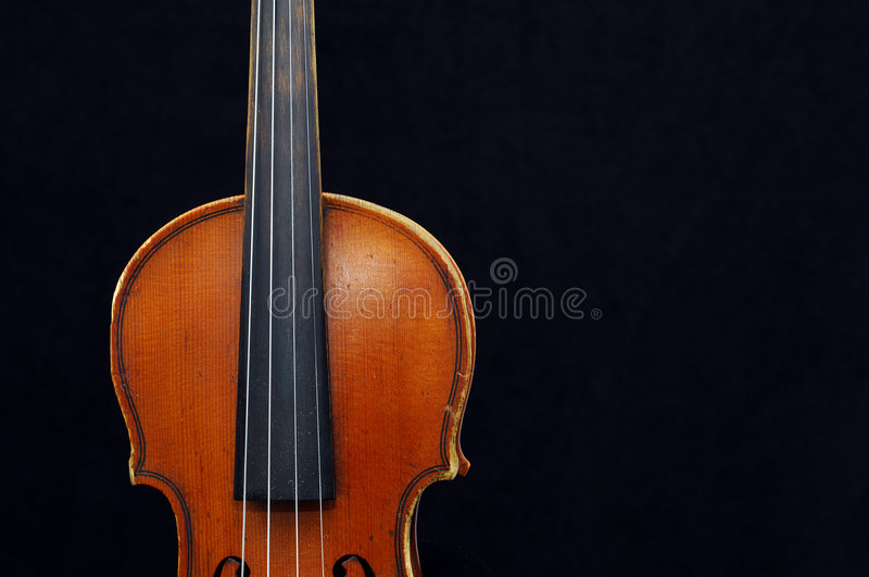 Violin. A view with a violin details on black stock photos