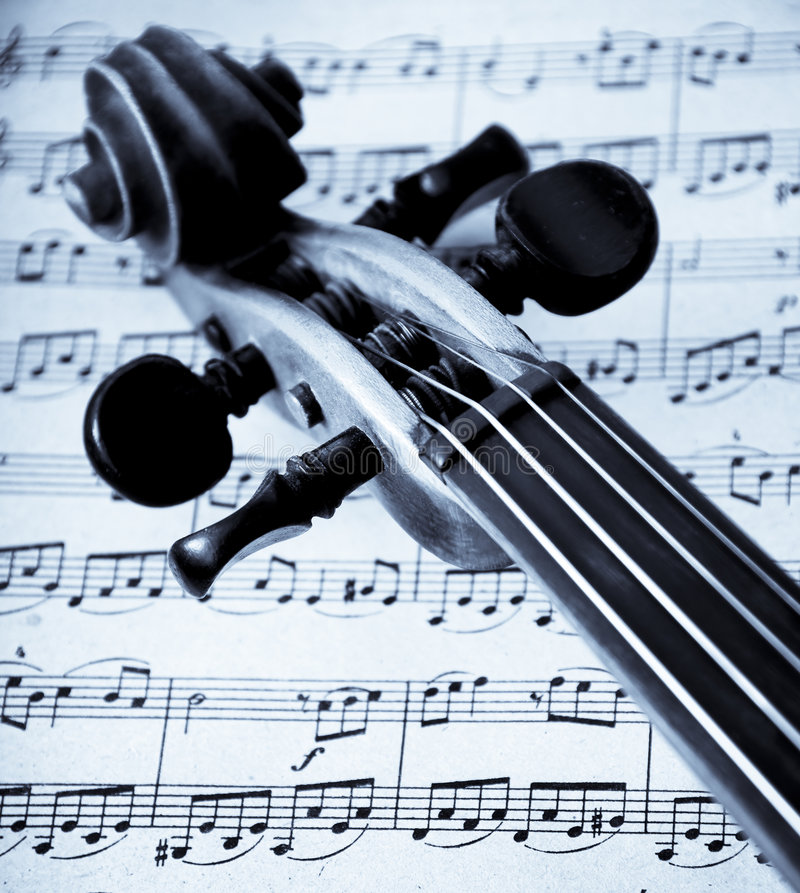 Violin. A view with a violin details on music sheets stock photography