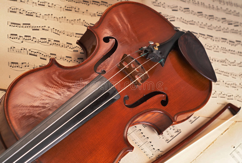 Violin. E over music notes stock photography