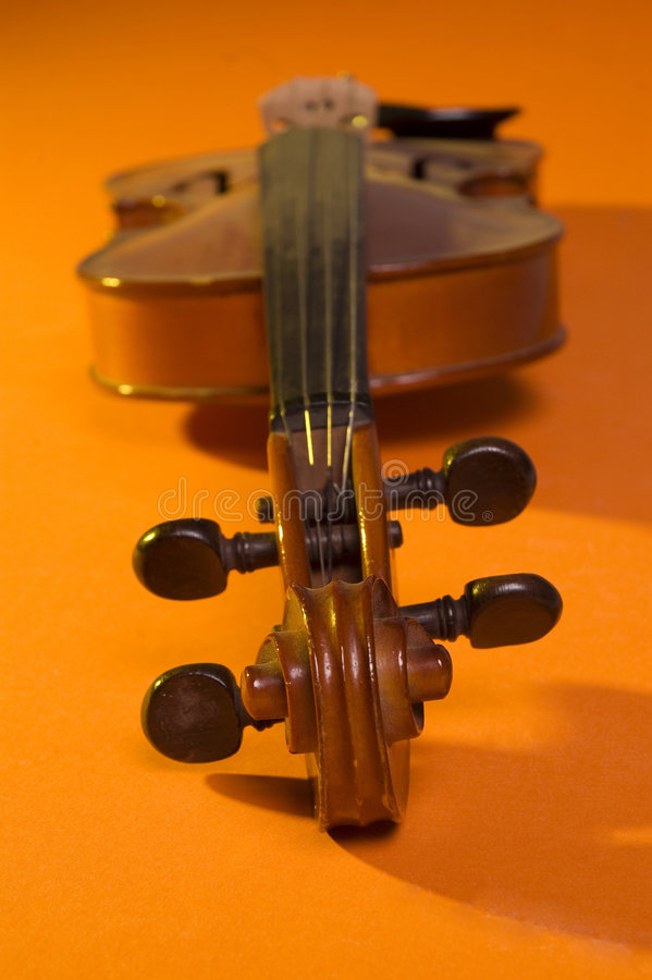 Violin. Old violin over a colorful background royalty free stock photography