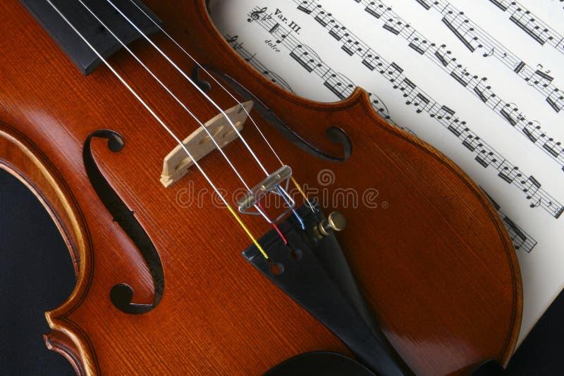Violin. Closeup of my personal violin resting on top of violin music stock photo