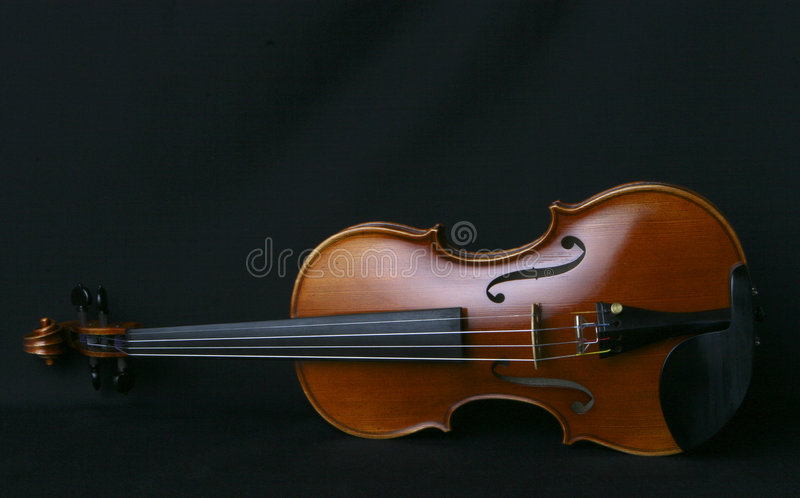 Violin. Closeup of my personal violin on a black background royalty free stock images