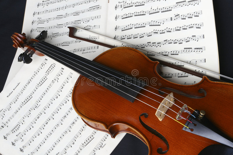 Violin. Still life and Closeup of violin, bow and music ready to be practiced royalty free stock photo