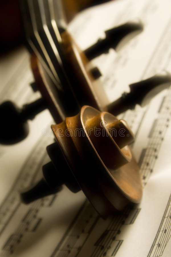 Violin. Shot of violin head over partiture, soft focus throughout the entire image gives it a dream like appearance stock photos
