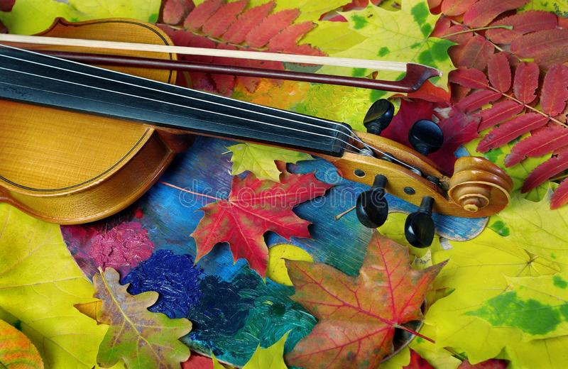 Violin and autumn leaves. Autumn mood. Copy spaces stock images