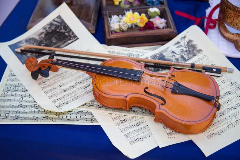 Violin bow on the background music. Wooden musical instruments royalty free stock image