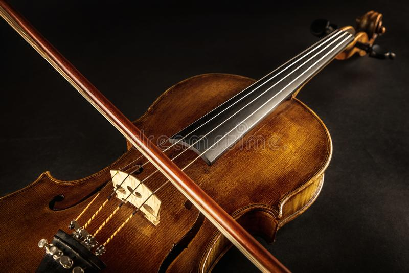 Violin and bow. Close up of a baroque violin and bow stock photo