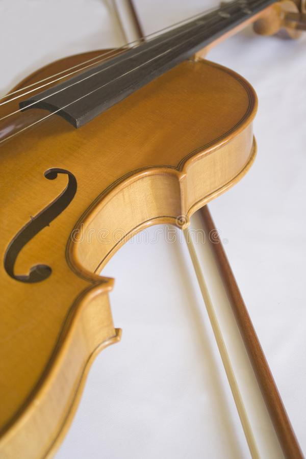 Violin and Bow in a White Table. Close up off violin and bow in a white background royalty free stock photography