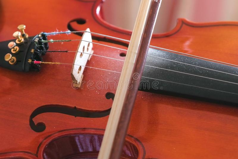 Violin and bow on the strings close-up view. stock images