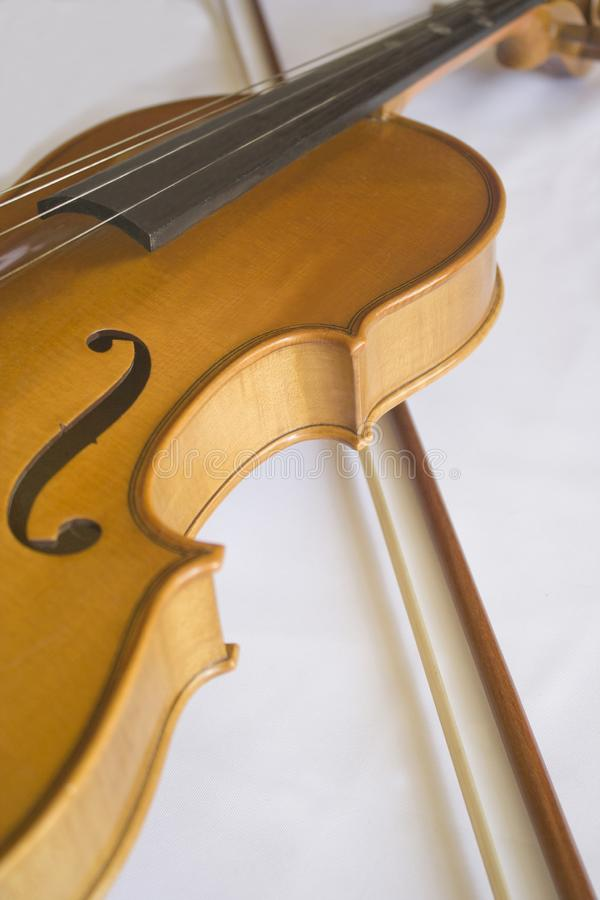 Violin and Bow on a white background. Close up off violin and bow in a white background royalty free stock photo