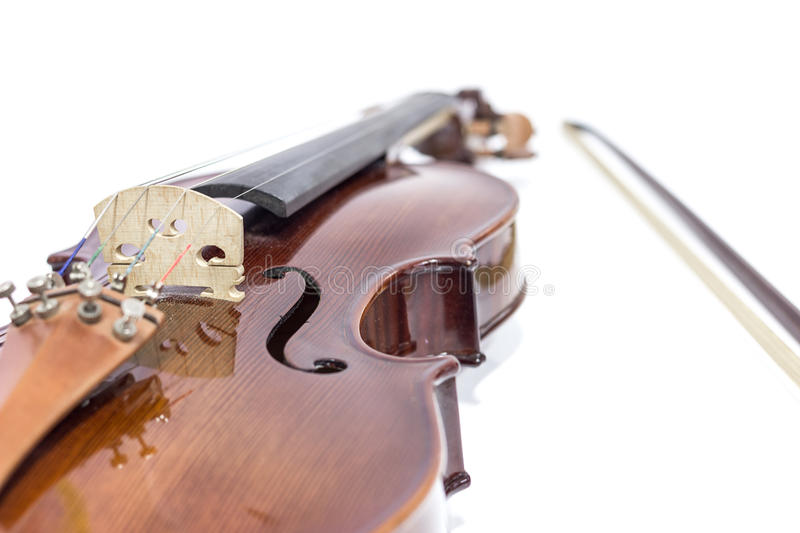 Violin and bow. On a white background, selective focus stock photos