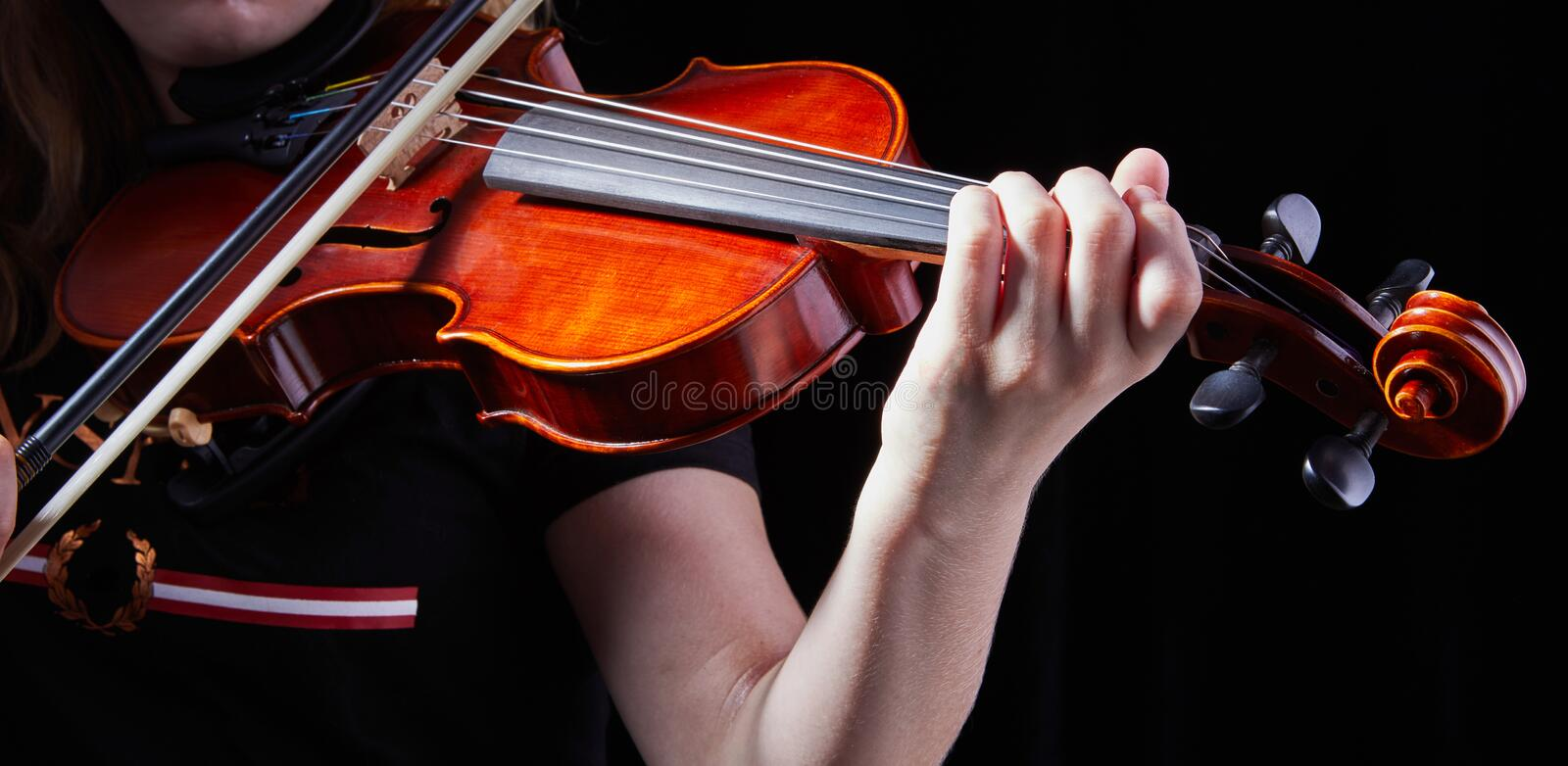 Violin classic musical instrument. Classic player hands on a black background. Details of violin playing. Orchestra, violinist, symphony, concert, musician stock photo