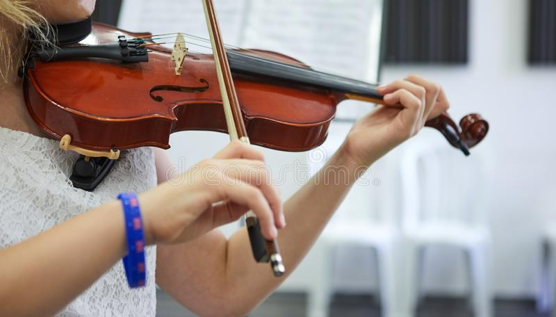 Violin classic musical instrument. Classical player hands. Details of violin stock image