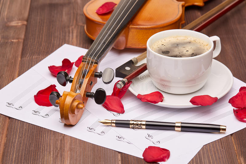 Violin and cup of coffee. royalty free stock image