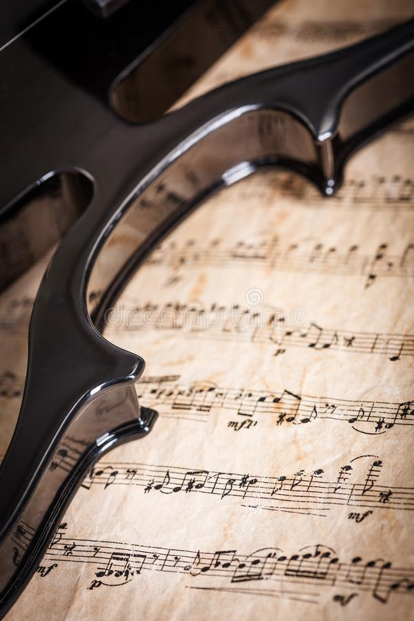 Violin detail with score stock images