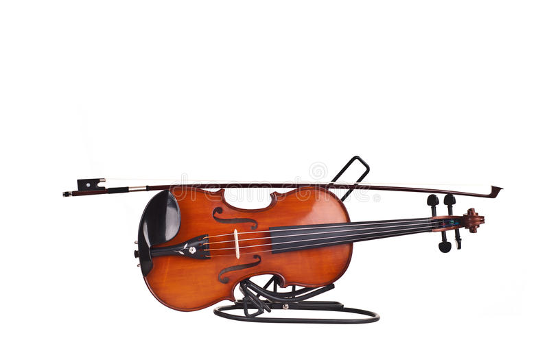 Violin and a fiddlestick. On white background royalty free stock photo