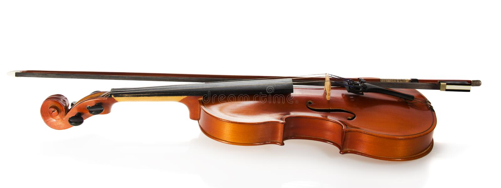 Violin and fiddlestick. Isolated on white royalty free stock images