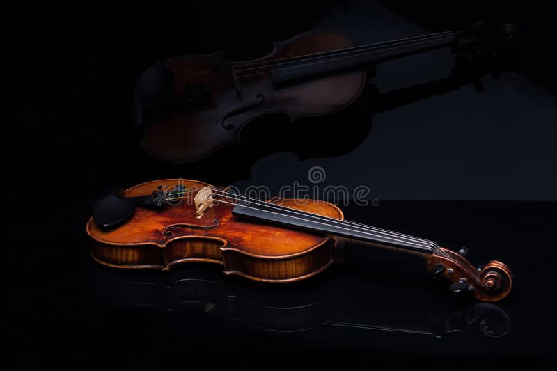 Violin front view, on a black background stock images