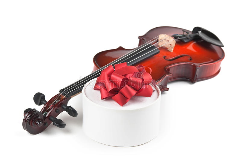 Violin and gift box. On white background stock photography