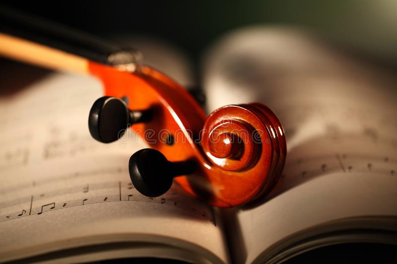 Violin handle on the open musical book stock image