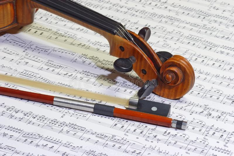 Violin head and bow royalty free stock photo