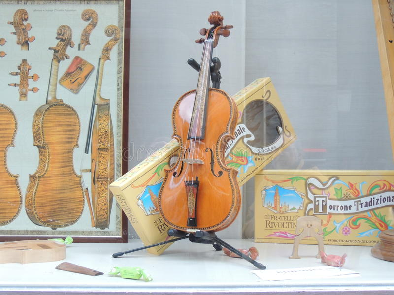 Violin Historical Shop. In Cremona, Lombardy, Italy. In Cremona was born the famous artist Stradivari and the violin has become the symbol of the town stock photos