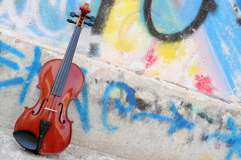 The violin. Violin leaning on the wall graffiti drawn stock photography