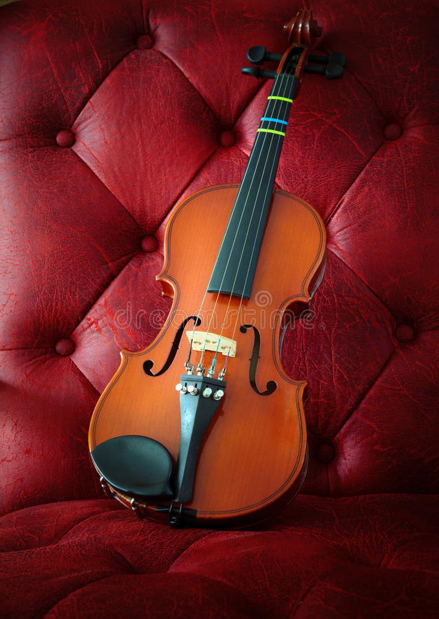 Violin On Luxury Red Leather Stock Photo