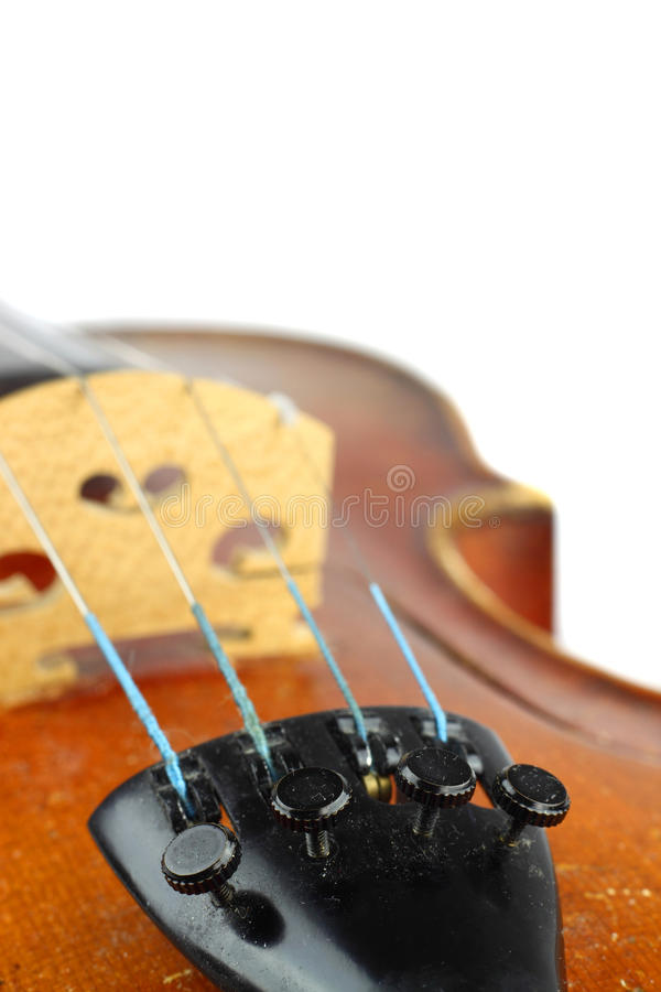Violin macro. Closeup. View on tailpiece with fine tuners and strings. Bridge and upper bout in background stock image