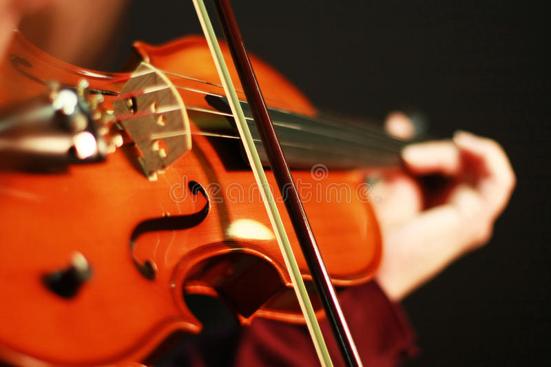 Violin Music Defined. Close-Up Selective Focus of Violin & Bow While Being Played by Musician royalty free stock photography