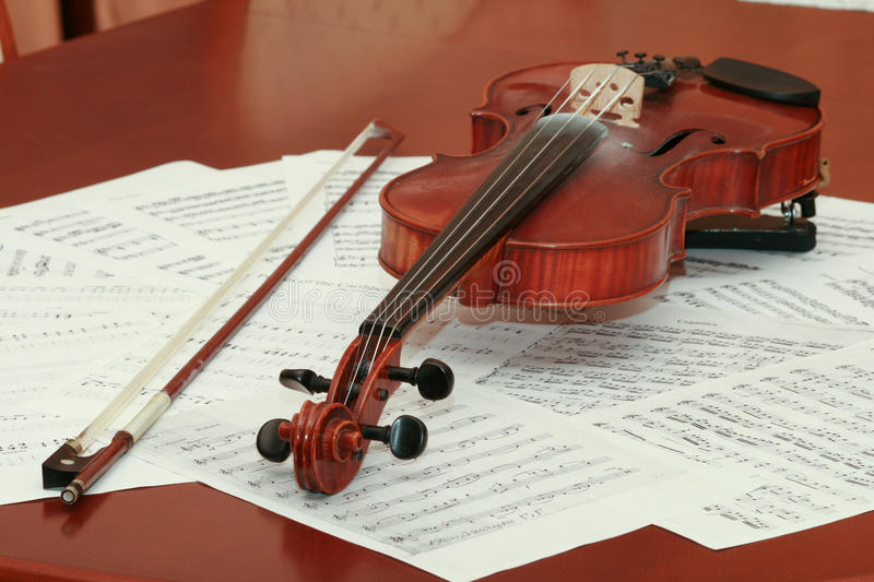 Violin. And notes on the table stock photo