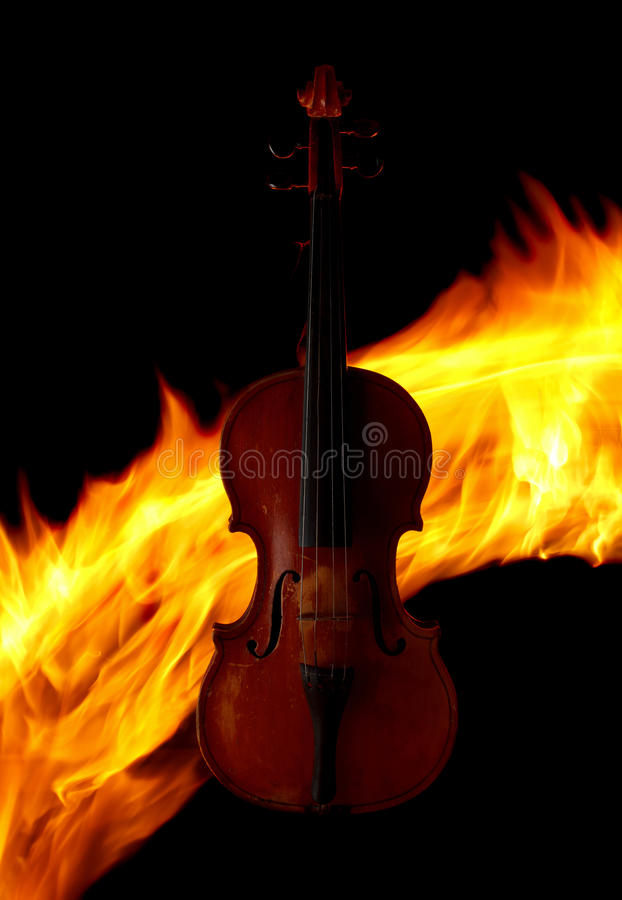 Violin over fire background stock photo