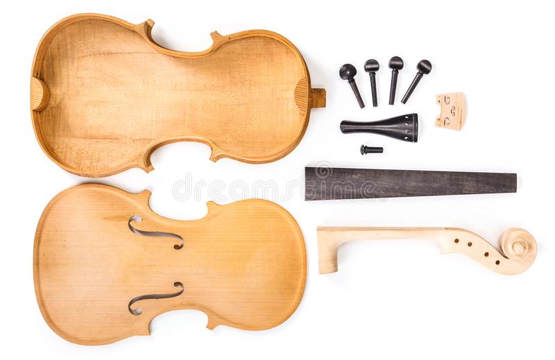 Violin parts. Raw violin parts on white background royalty free stock photography