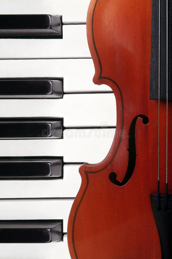 Violin and piano. Violin lying on the piano stock photos