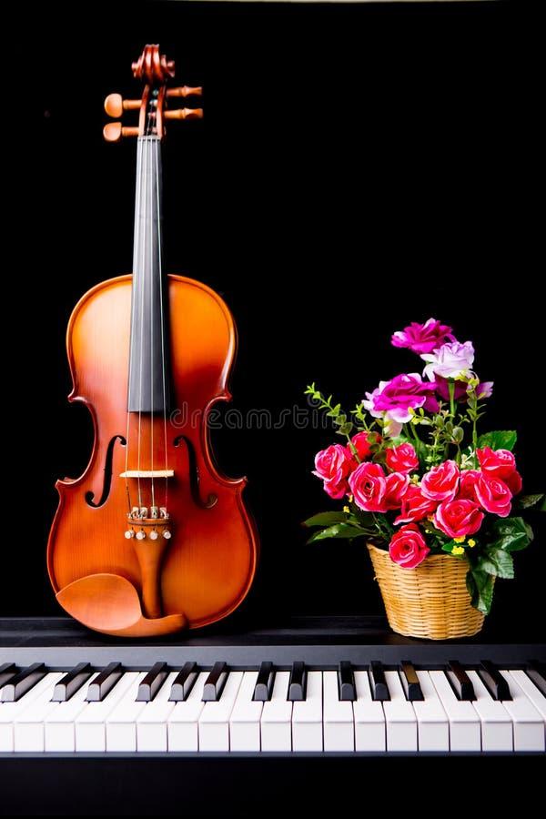 Violin on the piano stock photos