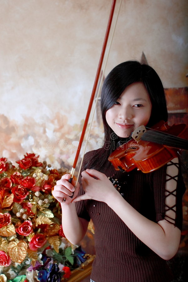 Violin player. I took this photo in a studio.She is a real violin player and I let her play it just like she is on the stage royalty free stock photography