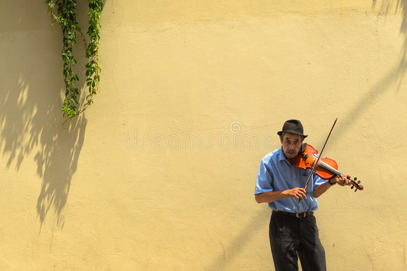 Violin Player. Street Performer Plays violin on July 17, 2013 in Barcelona, Spain royalty free stock photos