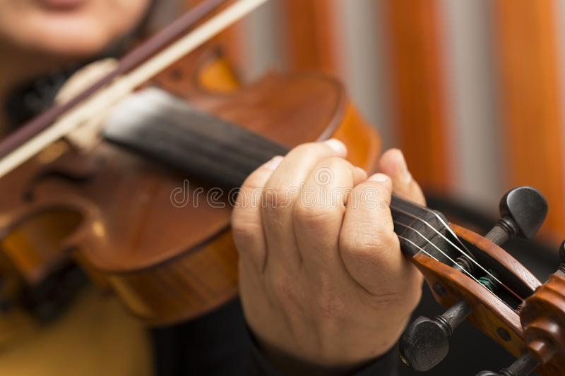 Violin playing female musician royalty free stock photos