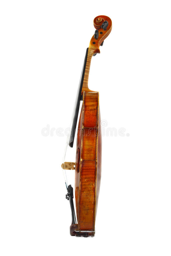 Violin profile. Profile view of old violin isolated on white stock image