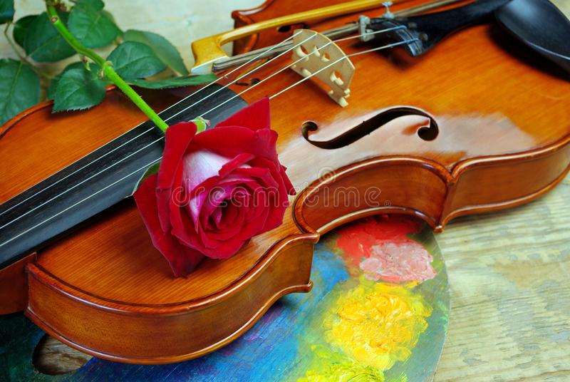 Violin, red rose and palette. close up stock image